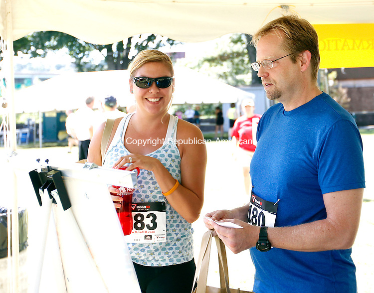 Waterbury, CT-09 September 2012-090912CM02-  Kathy Matula, left, of Southbury and Dan Alt of Waterbury check out the race route before the start of the 7th annual Bob Veillette 5k fundraising race Sunday morning in Waterbury.  Veillette, a longtime managing editor of the Republican-American, was paralyzed several years ago by a stroke. Christopher Massa Republican-American