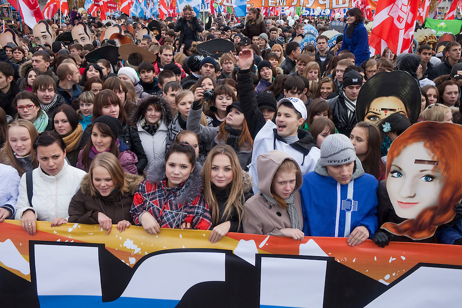 "Moscow, Russia, 04/11/2011..On Russian National Unity Day members of the pro-Kremlin youth group ""Nashi"" hold their own Russian March to counter the racist and xenophobic sentiments of the nationalist Russian March held on the same day for the last several years. Demonstrators wore masks of images of various Russian ethnic groups in a call for national unity and ethnic harmony."
