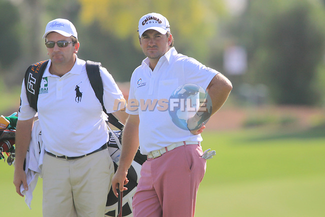 Greame McDowell  on the 18th green during the opening round of Day 1 at the Dubai World Championship Golf in Jumeirah, Earth Course, Golf Estates, Dubai  UAE, 19th November 2009 (Photo by Eoin Clarke/GOLFFILE)