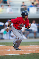 Kamran Young (27) of the Elizabethton Twins hustles down the first base line against the Kingsport Mets at Hunter Wright Stadium on July 9, 2015 in Kingsport, Tennessee.  The Twins defeated the Mets 9-7 in 11 innings. (Brian Westerholt/Four Seam Images)