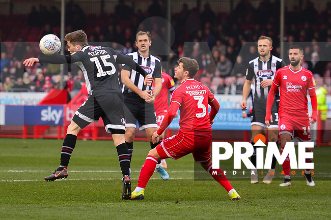 Harry Clifton in action against Josh Doherty during the Sky Bet League 2 match between Crawley Town and Grimsby Town at The People's Pension Stadium, Crawley, England on 25 January 2020. Photo by Lee Blease.
