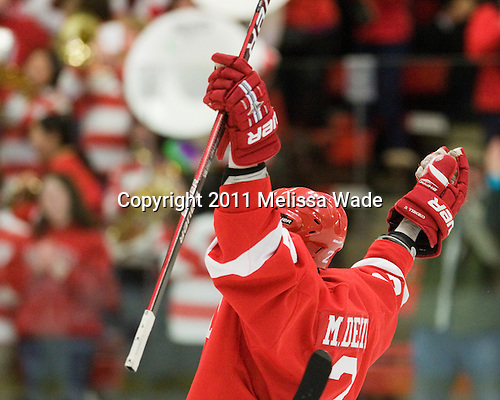 Mike Devin (Cornell - 2) celebrates his goal which opened scoring in the game. - The visiting Cornell University Big Red defeated the Harvard University Crimson 2-1 on Saturday, January 29, 2011, at Bright Hockey Center in Cambridge, Massachusetts.