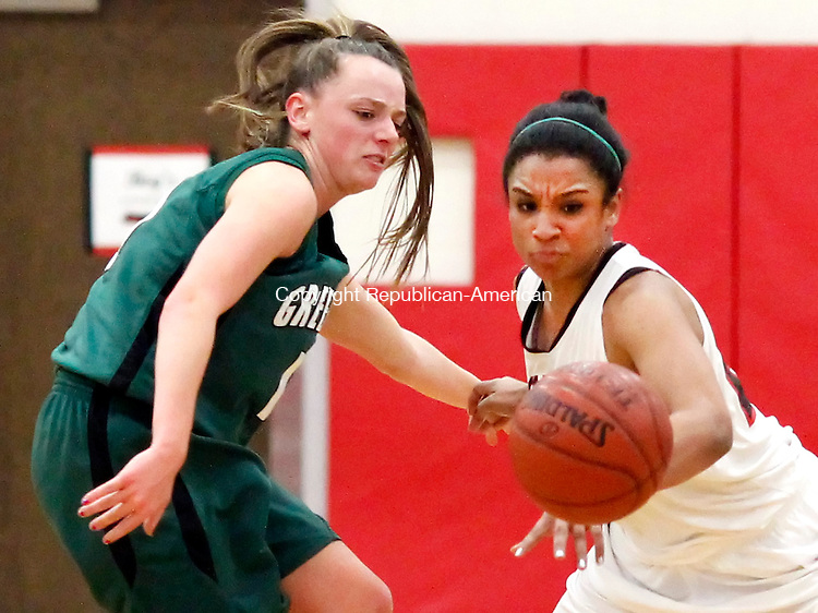 Southbury, CT-04 January 2013-010413CM08-  Pomperaug's Gabbie Holness makes the steal away from New Milford's Jess Noteware during their SWC matchup Friday night in Southbury.  Pomperaug won big, 61-32.   Christopher Massa Republican-American