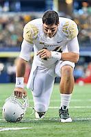 Baylor quarterback Bryce Petty (14) says a prayer before an NCAA Football game kickoff, Saturday, November 29, 2014 in Arlington, Tex. (Mo Khursheed/TFV Media via AP Images)