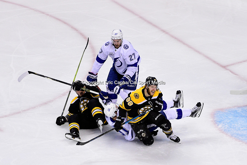 May 2, 2018: Boston Bruins right wing David Pastrnak (88) reacts as Tampa Bay Lightning center Steven Stamkos (91) rolls over his leg during game three of the second round of the National Hockey League's Eastern Conference Stanley Cup playoffs between the Tampa Bay Lightning and the Boston Bruins held at TD Garden, in Boston, Mass. Tampa Bay defeats Boston 4-1. Eric Canha/CSM