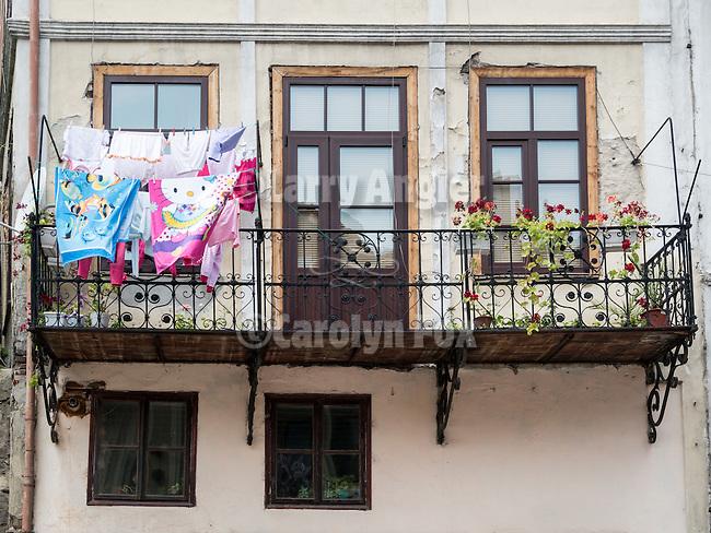 Drying laundry on a balcony along the historic streets of Veliko Tarnovo, Bulgaria