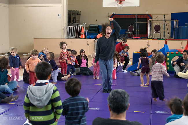 Albany CA Gymnastics instructor leading toddlers in jumping activity during parent-child gym program
