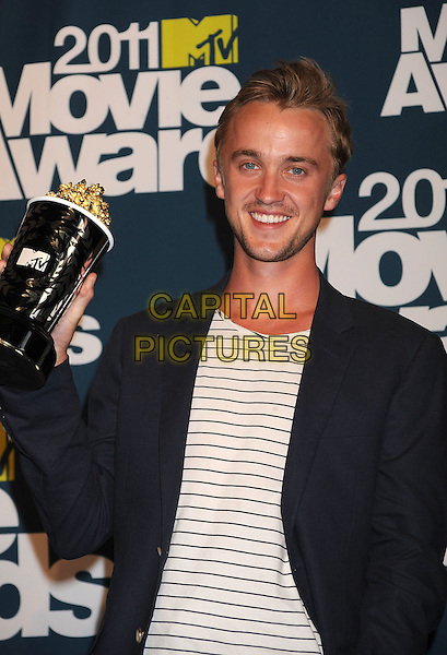 Tom Felton.in the Press Room at the 2011 MTV Movie Awards at Universal Studios' Gibson Amphitheatre in Universal City, California, USA, June 5th 2011.  .pressroom half length white striped jacket t-shirt .CAP/ROT/TM.©TM/Roth Stock/Capital Pictures