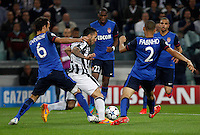 Calcio, quarti di finale di andata di Champions League: Juventus vs Monaco. Torino, Juventus stadium, 14 aprile 2015.<br /> Juventus' Carlos Tevez, center, is challenged by Monaco's Ricardo Carvalho, left, and Fabinho, during the Champions League quarterfinals first leg football match between Juventus and Monaco at Juventus stadium, 14 April 2015.<br /> UPDATE IMAGES PRESS/Isabella Bonotto