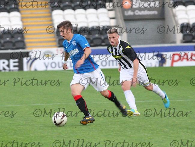 Charlie Telfer being watched by Kealan Dillon in the St Mirren v Rangers Scottish Professional Football League Under 20 match played at St Mirren Park, Paisley on 10.9.13.