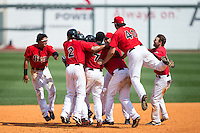 The Birmingham Barons mob teammate Christian Marrero (24) after his walk-off 2-run single in the bottom of the 13th innings against the Tennessee Smokies at Regions Field on May 4, 2015 in Birmingham, Alabama.  The Barons defeated the Smokies 4-3 in 13 innings. (Brian Westerholt/Four Seam Images)