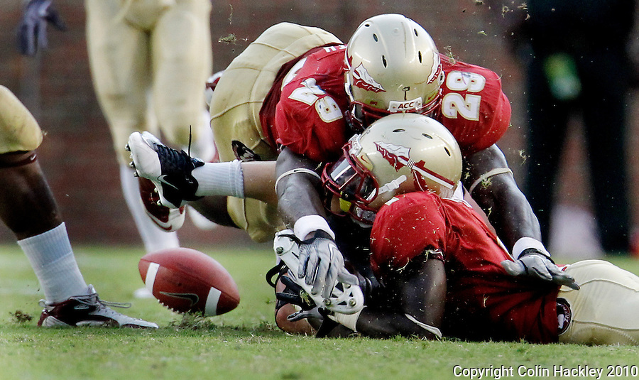 TALLAHASSEE, FL 9/25/10-FSU-WF FB10 CH-Florida State's Kendall Smith and Mike Harris collide with Wake Forest's Tommy Bohanon forcing a fumble during fourth quarter action Saturday at Doak Campbell Stadium in Tallahassee. The Seminoles beat the Demon Deacons 31-0..COLIN HACKLEY PHOTO