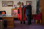 Mayor of Barking Councillor Abdul Aziz   getting robed up in the Mayors Parlour prior to the Nepton Distribution Barking Essex 2019