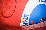 A Remax hot air balloon is slowly inflated at the 2008 Shenandoah Valley Hot Air Balloon and Wine Festival at Historic Long Branch in Millwood, Virginia.