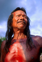 Portrait of an elderly long-haired man, Krahô indigenous people, body painting with urucum, Tocantins State, Brazil. Urucum is the Tupi name ( red color ) for Achiote ( Bixa orellana ), a shrub or small tree originating from the tropical region of the Americas. Central and South American natives originally used the seeds to make red body paint and lipstick.