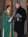 Canon Eugene Sweeney who was inducted as the new Parish Priest of St Peter's parish Drogheda speaks with Edward Holly. Photo:Colin Bell/pressphotos.ie