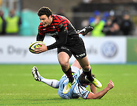 Hendon, England. Duncan Taylor of Saracens in action  during the LV= Cup match for the first professional rugby game on the artificial turf pitch made for rugby between Saracens and Cardiff Blues at Allianz Park Stadium on January 27, 2013 in Hendon, England.