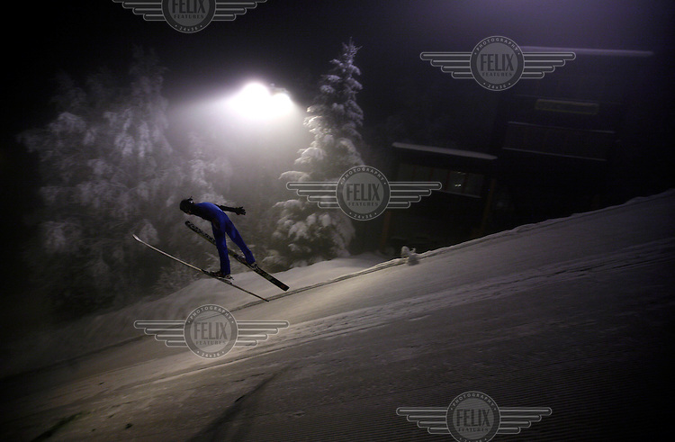 A young boys about to land in Linderudkollen ski jump arena.