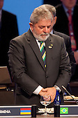 Luiz Inacio Lula da Silva, Brazil's president, stands for a moment in silence for recently deceased Polish President Lech Kaczynski during the Nuclear Security Summit at the Washington Convention Center in Washington, D.C., U.S., on Tuesday, April 13, 2010. Ukraine's agreement to relinquish its entire stockpile of highly enriched uranium gave U.S. President Barack Obama the first concrete result for a summit he convened on securing the world's atomic material. .Credit: Andrew Harrer / Pool via CNP