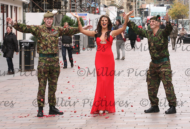 Sergeant Daniel Lafferty (right) and Fusileer Ronnie Cameron of the Royal Regiment of Scotland with Nieve Jennings promoting the seven-piece range of silver and gold earrings, pendants and brooches which are intended to raise money for the Scottish Poppy Appeal. Ortak, St Enoch Centre, Glasgow.