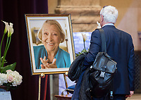 A man pays his respects to Lise Payette during a memorial service in her honour at City Hall in Montreal, Saturday, October 20, 2018. THE CANADIAN PRESS/Graham Hughes
