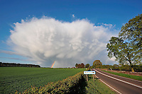 Cumulus storm cloud with rainbow coming from the bottom, Wetheral, Cumbria.....Copyright..John Eveson,.Dinkling Green Farm,.Whitewell,.Clitheroe,.Lancashire..BB7 3BN.Tel. 01995 61280.Mobile 07973 482705.j.r.eveson@btinternet.com.www.johneveson.com
