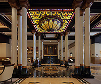 Inside the lobby of the Driskill Hotel, with columns, marble floor and stained glass ceiling light, built 1886 in Romanesque Revival style by cattle baron Jesse Driskill, on East 6th St or Dirty Sixth, in the Sixth Street Historic District in downtown Austin, Texas, USA. The area was Austin's commercial district in the late 19th century, and the buildings are mainly Victorian brick structures. It is now known for its lively bars, cafes, nightclubs and music venues. Picture by Manuel Cohen