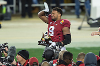 SANTA CLARA, CA - DECEMBER 30, 2014: James Vaughters holds the Foster Farms Defense MVP Trophy after Stanford's game against Maryland in the 2014 Foster Farms Bowl.  The Cardinal defeated the Terrapins 45-21.