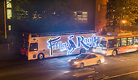 "Bright LED illuminated advertising for the Broadway show, ""Fiddler on the Roof"" on the side of a tour bus parked in New York on Thursday, June 30, 2016. (© Richard B. Levine)"