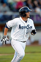 D.J. Peterson #33 of the Everett AquaSox runs the bases during a game against the Tri-City Dust Devils at Everett Memorial Stadium on July 23, 2013 in Everett, Washington. Everett defeated Tri-City, 3-2. (Larry Goren/Four Seam Images)