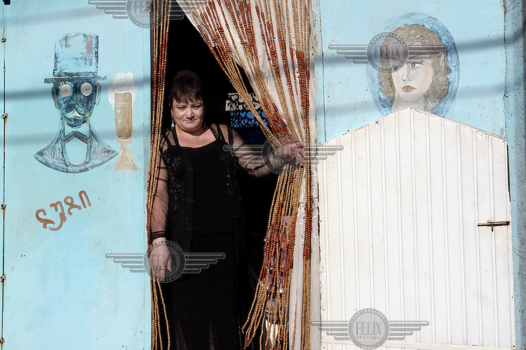 A woman stands in the doorway of a bar in Batumi..