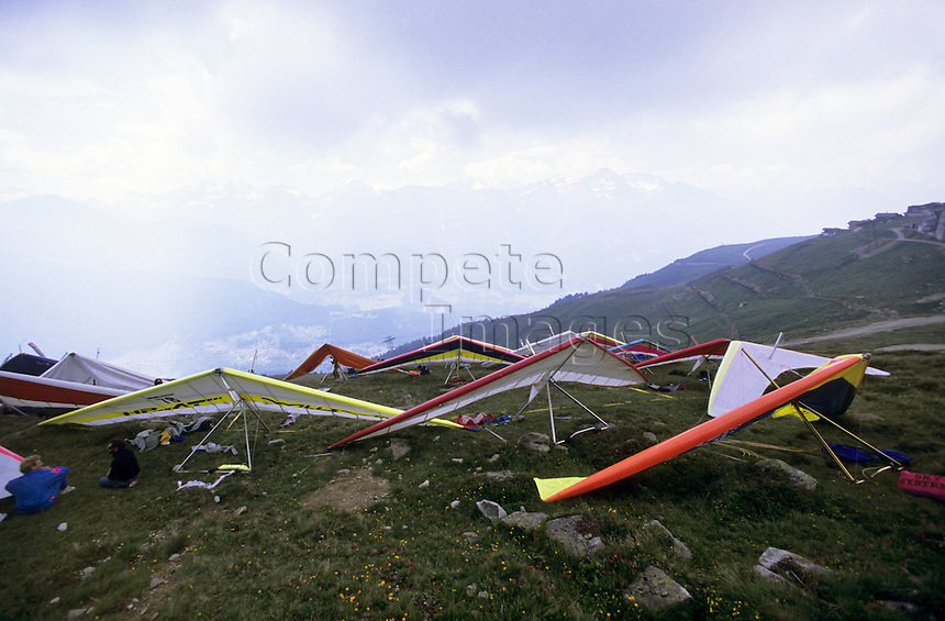 Hang gliders on a hill side
