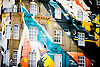 Painted building in London in green, black, blue, yellow and orange.