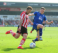 Lincoln City's Neal Eardley battles with Tranmere Rovers' Paul Mullin<br /> <br /> Photographer Andrew Vaughan/CameraSport<br /> <br /> The EFL Sky Bet League Two - Lincoln City v Tranmere Rovers - Monday 22nd April 2019 - Sincil Bank - Lincoln<br /> <br /> World Copyright © 2019 CameraSport. All rights reserved. 43 Linden Ave. Countesthorpe. Leicester. England. LE8 5PG - Tel: +44 (0) 116 277 4147 - admin@camerasport.com - www.camerasport.com