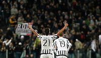 Calcio, Serie A: Juventus vs Milan. Torino, Juventus Stadium, 21 novembre 2015. <br /> Juventus&rsquo; Paulo Dybala, left, celebrates past his teammate Leonardo Bonucci after scoring the winning goal during the Italian Serie A football match between Juventus and AC Milan at Turin's Juventus stadium, 21 November 2015. Juventus won 1-0.<br /> UPDATE IMAGES PRESS/Isabella Bonotto