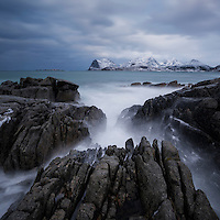 Rocky coastline of Flakstadøy overlooking Nappstraumen, Lofoten Islands, Norway