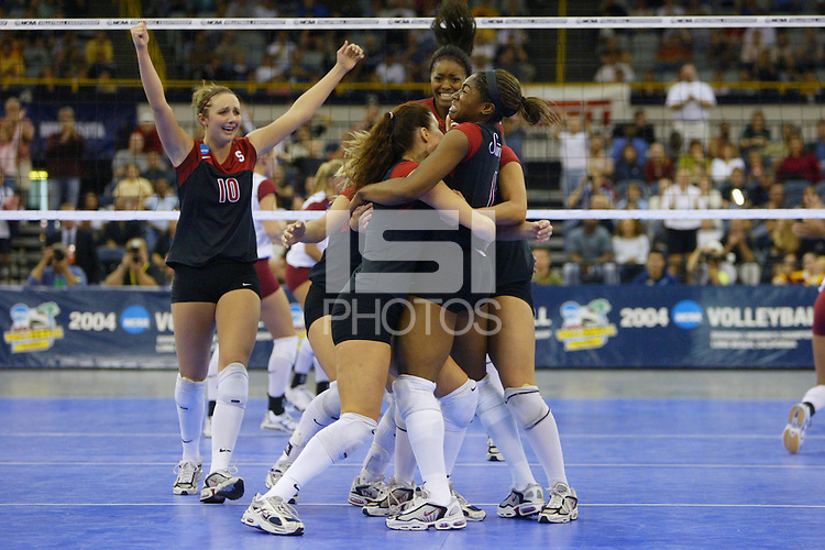 18 December 2004: The Stanford team celebrates match point during Stanford's  30-23, 30-27, 30-21 victory over Minnesota in the 2004 NCAA Women's Volleyball National Championships in Long Beach, CA. Stanford won their sixth women's volleyball title in school history. Pictured are Kristin Richards, Jennifer Hucke, Franci Girard, Ogonna Nnamani, and Leahi Hall.<br />