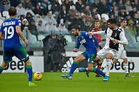 1st December 2019; Allianz Stadium, Turin, Italy; Serie A Football, Juventus versus Sassuolo; Emre Can of Juventus challenges Francesco Magnanelli of Sassuolo - Editorial Use