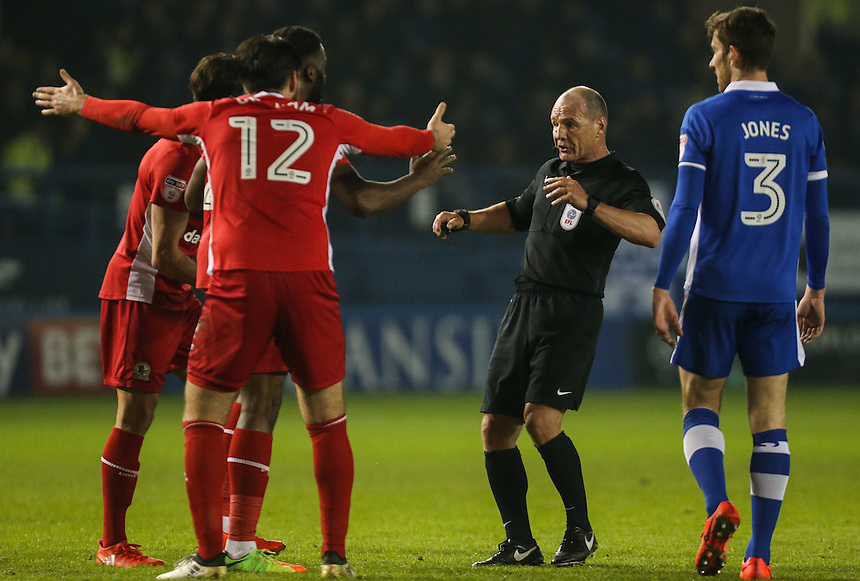Blackburn Rovers players surround referee Scott Duncan after he chalked off Hope Akpan's goal<br /> <br /> Photographer Alex Dodd/CameraSport<br /> <br /> The EFL Sky Bet Championship - Sheffield Wednesday v Blackburn Rovers - Tuesday 14th February 2017 - Hillsborough - Sheffield<br /> <br /> World Copyright &copy; 2017 CameraSport. All rights reserved. 43 Linden Ave. Countesthorpe. Leicester. England. LE8 5PG - Tel: +44 (0) 116 277 4147 - admin@camerasport.com - www.camerasport.com