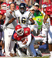 Florida International University Golden Panthers versus the University of Arkansas Razorbacks at Donald W. Reynolds Razorback Stadium, Fayetteville, Arkansas on Saturday, October 27, 2007.  The Razorbacks defeated the Golden Panthers, 58-10...Arkansas defensive back Jarell Norton (27) is finally tripped up by FIU after intercepting a Wayne Younger pass in the first quarter.