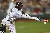Mississippi State outfielder Demarcus Henderson (2) misses on a bunt attempt during Game 1 of the 2013 Men's College World Series Finals against the UCLA Bruins on June 24, 2013 at TD Ameritrade Park in Omaha, Nebraska. The Bruins defeated the Bulldogs 3-1, taking a 1-0 lead in the best of 3 series. (Andrew Woolley/Four Seam Images)