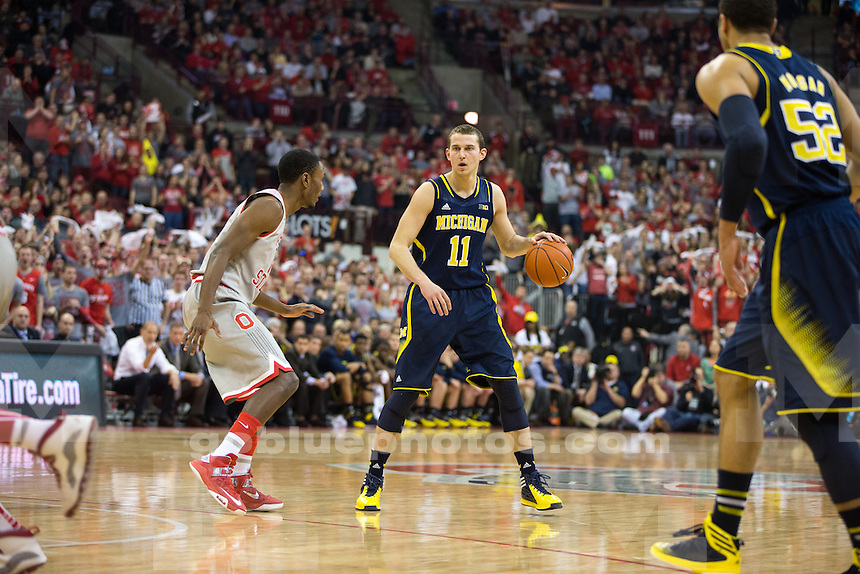 The University of Michigan men's basketball team defeats Ohio State, 70-60, at Value City Arena in Columbus, Ohio.