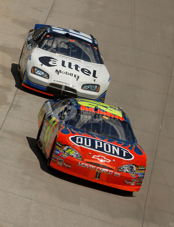 June 4, 2006; Dover, DE, USA; Nascar Nextel Cup driver Jeff Gordon (24) leads Ryan Newman (12) during the Neighborhood Excellence 400 at Dover International Speedway. Mandatory Credit: Mark J. Rebilas