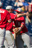 North Carolina State third baseman Grant Clyde (22) hugs pitcher Carlos Rodon (16) after his complete game in Game 3 of the 2013 Men's College World Series between the North Carolina State Wolfpack and North Carolina Tar Heels at TD Ameritrade Park on June 16, 2013 in Omaha, Nebraska. The Wolfpack defeated the Tar Heels 8-1. (Andrew Woolley/Four Seam Images)
