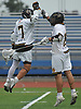 Andrew McAdorey #7 of St. Anthony's, left, gets congratulated by Anthony Culley #19 after he scored a goal in the Nassau-Suffolk CHSAA varsity boys lacrosse Class AA final against Chaminade at Mitchel Athletic Complex on Tuesday, May 15, 2018. The game went to halftme tied 8-8 when a prolonged lightning storm forced a postponement.