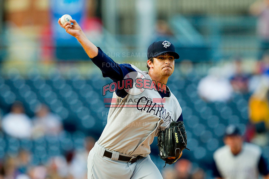 Charlotte Knights starting pitcher Andre Rienzo (25) makes a pick-off throw to first base against the Toledo Mudhens at 5/3 Field on May 3, 2013 in Toledo, Ohio.  The Knights defeated the Mudhens 10-2.  (Brian Westerholt/Four Seam Images)