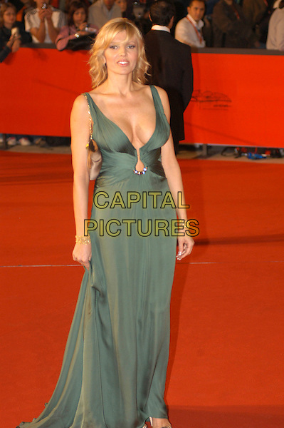 """RITA RUSTIC.Attends the film premiere of """"Fur: An Imaginary Portrait of Diane Arbus""""  during the first day of the Rome Film Festival, Roma, Italy,.October 13th 2006..full length green dress gown red carpet low cut cleavage.Ref: CAV.www.capitalpictures.com.sales@capitalpictures.com.©Luca Cavallari/Capital Pictures."""