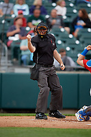 Umpire Brian Peterson calls a strike during an International League game between the Norfolk Tides and Buffalo Bisons on June 21, 2019 at Sahlen Field in Buffalo, New York.  Buffalo defeated Norfolk 1-0, the second game of a doubleheader.  (Mike Janes/Four Seam Images)