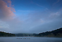 24/08/14 <br /> <br /> After overnight temperatures drop to an unseasonable three degrees, low cloud shrouds the hillside as steam rises from Ladybower Reservoir in the Derbyshire Peak District.<br /> <br /> All Rights Reserved: F Stop Press Ltd. +44(0)1335 300098   www.fstoppress.com.