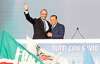 Il leader del Popolo della Liberta' Silvio Berlusconi, a destra, col segretario Angelino Alfano, sul palco durante la manifestazione contro tasse, burocrazia e sistema giudiziario, in piazza del Popolo a Roma, 23 marzo 2013..Italian center-right People of Freedom (PdL) party's leader Silvio Berlusconi, right, with secretary Angelino Alfano, attends a demonstration against austerity measures, burocracy and judicial system, in Rome, 23 March 2013..UPDATE IMAGES PRESS/Isabella Bonotto